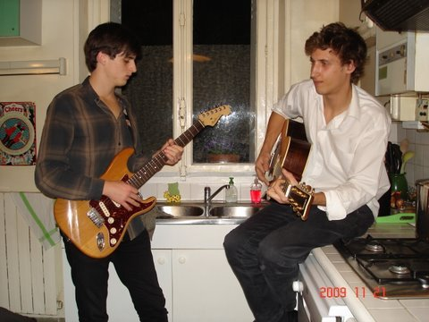 Tom left abruptly for Paris after Christmas in 2007. Here he is on the ever-present guitar with Leo, a friend there. I found this on FaceBook.