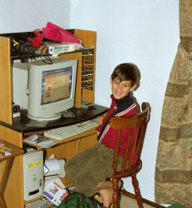 Here he is after moving back in with us in the summer of 1999 (see our history), with his birthday eMachines computer.