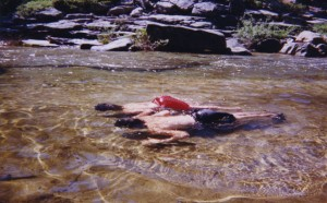 Nick and Tom float with their heads under water in the freezing pool we found at the top of Yosemite Falls.