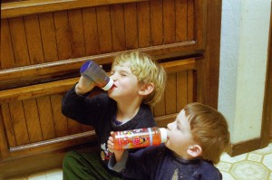 This was taken in April 1999, before the kitchen was renovated. Charlie and Alex were both sitting on the kitchen floor. Nous aimons nos biberons!