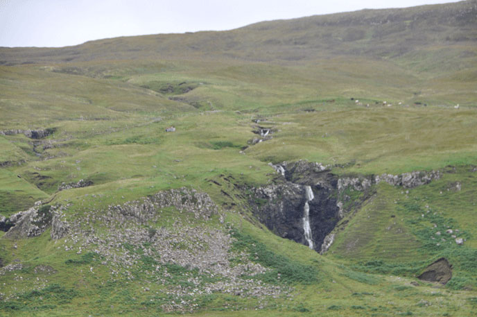 A stream tumbling down a Skye hillside. The Isle of Skye is just off the northwest coast of Scotland.